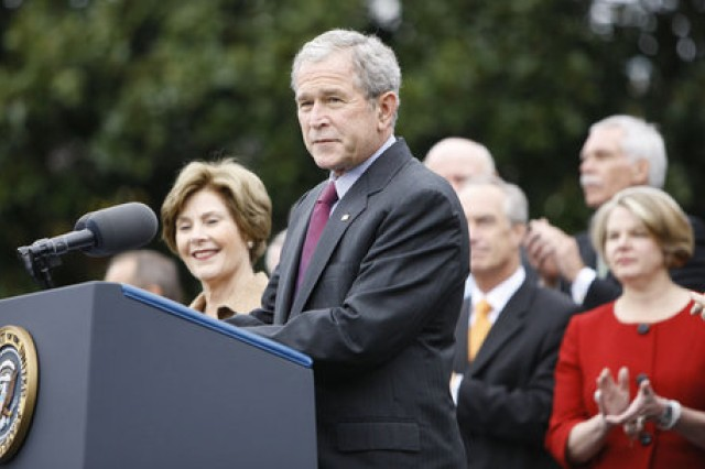 President George W. Bush, addressing members of his Cabinet, on the South Lawn of the White House Thursday