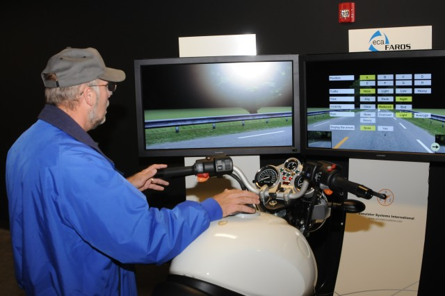 Richard Hearron, garrison safety manager, demonstrates a night riding scenario on a new motorcycle simulator in Building 737 at Marshall Army Airfield. The new facility also has 25 car simulators for beginning and high-risk drivers to practice on.