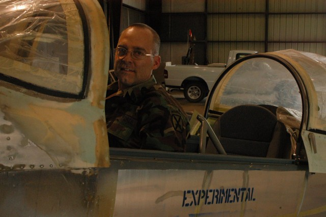 Maj. Chris Mallory sits in the cockpit of his nearly completed airplane.