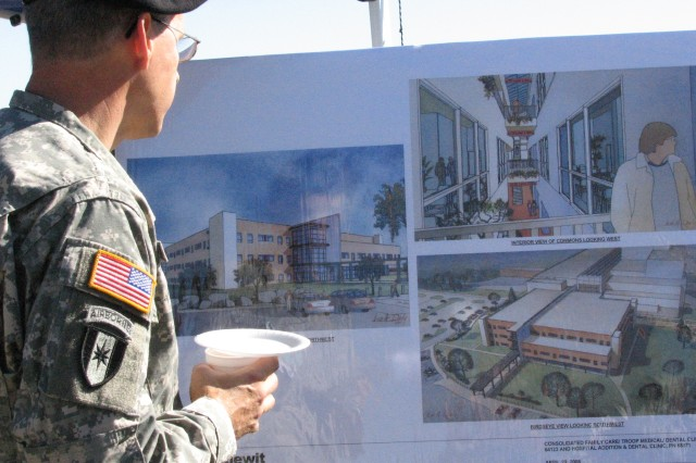 Col. Richard Wahl, pathology, Evans Army Community Hospital, studies the artist's renderings of the new Soldier Family Health Clinic at Evans Army Community Hospital on Fort Carson. Ground was broken for the building Oct. 31 and should be completed in two years.