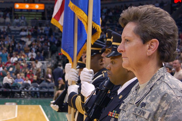 MILWAUKEE -- Col. Linda Ross, U.S. Army Recruiting Command Center One command psychologist, prepares to adminster the oath of enlistment to Future Soldiers during the halftime of Milwaukee Bucks vs. Phoenix Suns game Nov. 8. A color guard from the U.S. Army Recruiting Battalion Milwaukee supported the event. In honor of Veterans Day, the Milwaukee Bucks hosted a color guard and Future Soldiers oath of enlistment.