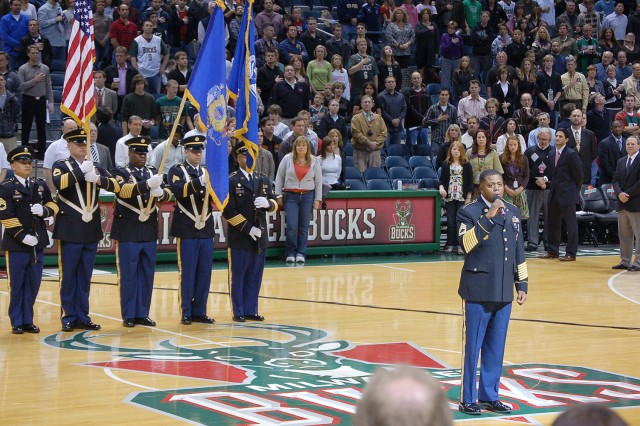 MILWAUKEE -- Sgt. 1st Class Dennis Robinson, a recruiter with the U.S. Army Recruiting Battalion Milwaukee, sings the national anthem at the start of the Milwaukee Bucks vs. Phoenix Suns game Nov. 8. In honor of Veterans Day, the Milwaukee Bucks hosted a color guard and Future Soldiers oath of enlistment.