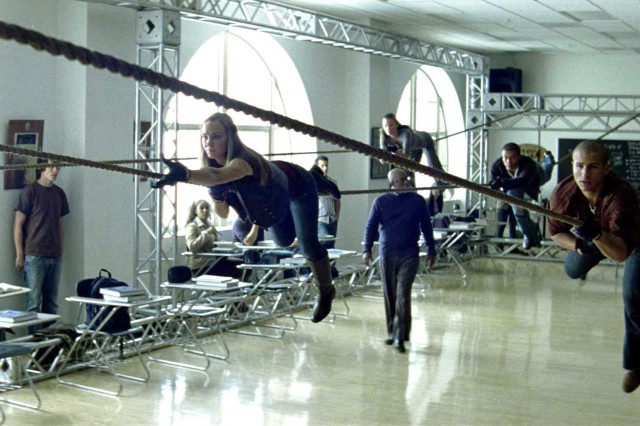 """Actors practice negotiating a rope obstacle in a UCLA classroom as part of the new ad """"School"""" that will begin airing on ESPN, MTV and the Speed Channel on Veterans Day."""