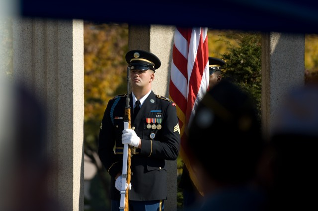 Members of the United Nations Command Honor Guard salute during the playing of Taps Nov. 11 at a Veteran's Day ceremony at Yongsan Garrison, Seoul, Republic of Korea.