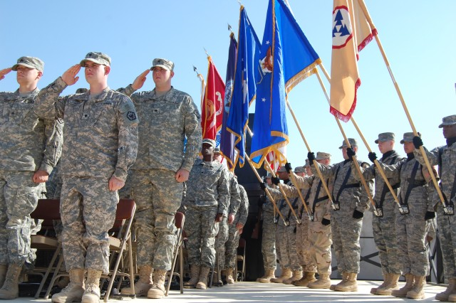 JOINT BASE BALAD, Iraq - Soldiers and members of a joint color guard render honors prior to a ceremony commemorating Veterans Day which included a mass reenlistment of over 25 service members on Joint Base Balad.