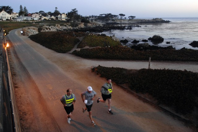 Army wounded warrior advocate Doug Miller runs along the Monterey, Calif., coast with Army Capt. D.J. Skelton, one of the wounded warriors in his oversight. A two-tour combat veteran, Miller joined the program after he retired at 65 and said he has no plans to quit.