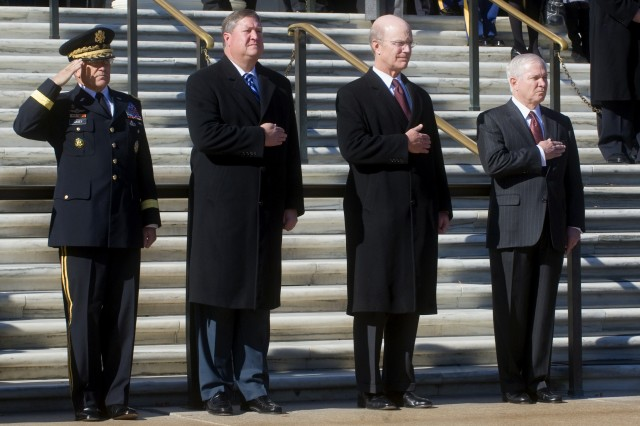 Army Chief of Staff Gen. George Casey, Secretary of the Air Force Michael Donley, Secretary of the Army Pete Geren, and Secretary of Defense Robert M. Gates render honors during the national anthem as the beginning of a Veterans Day ceremony at the Tomb of the Unknowns, Arlington National Cemetery, Va., Nov. 11, 2008.