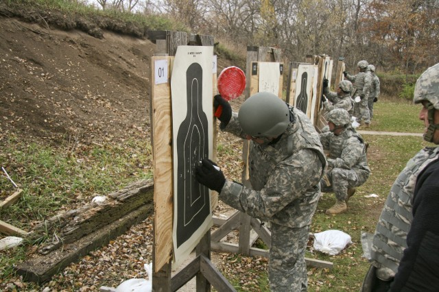 Sgt. 1st Class Danny Morales scores hits for a U.S. Army Sustainment Command Soldier during M9 Pistol qualification at Klaes-Tralau Memorial Range near Shaffton, Iowa, about 20 miles north east of Rock Island Arsenal Nov. 7. Soldiers of ASC manned the range during the week to support the command's training requirements on the M9 Pistol and the M16A2 Rifle.