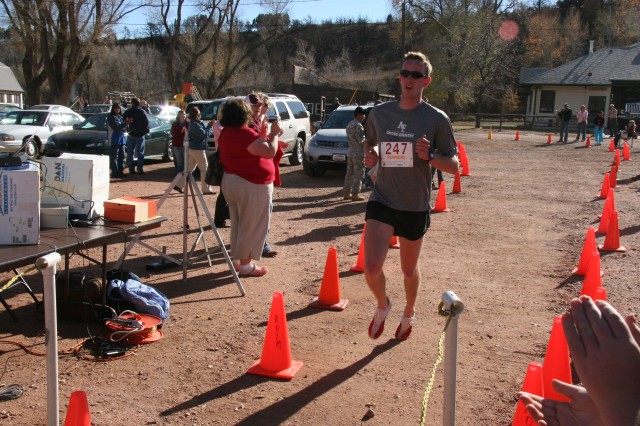 Andy Schweitzer, a cadet second class from the US Air Force Academy, was the first runner to cross the finish line. Schweitzer ran the four mile race in 23 minutes and 50 seconds.