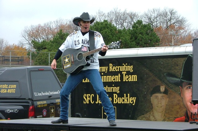Sgt. 1st Class Jamie Buckley, United States Army Recruiting Entertainment Team, performs at the Northwestern University tailgate before the Veterans Day game in Evanston, Ill. November 8, 2008.