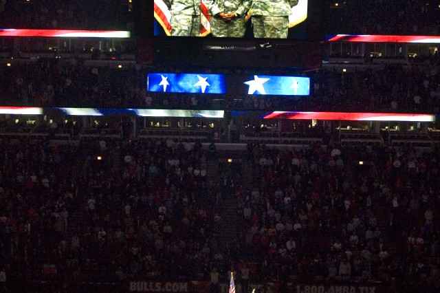 A video of Capt. Terry Joiner, Capt. Roselyn Tillman, Sgt. 1st Class Dennis Whitfield, Multi-National Corps- Iraq, singing the National Anthem plays on the Chicago Bulls scoreboard for 20,000 fans at the Veterans Day game, Nov. 11, 2008.
