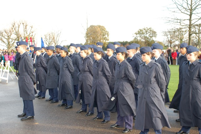 Junior ROTC from AFNORTH International School in Brunssum, Netherlands stand their official positions during strong winds at the 2008 Veterans Day Ceremony at the American Military Cemetery, Margraten, Netherlands.