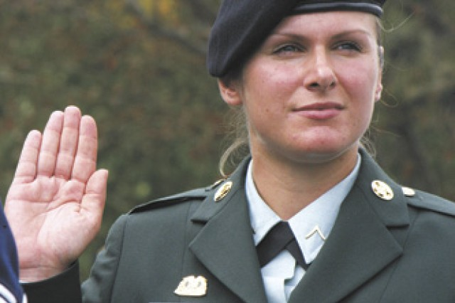 Texas National Guard Soldier Pvt. Simone Garner, originally from Germany, is sworn in as a U.S. citizen during a naturalization ceremony at the Veterans Day ceremony Nov. 11 at the Fort Sam Houston National Cemetery. Garner is a parachute rigger with the 294th Quartermaster Company (Airborne) in Austin, Texas.