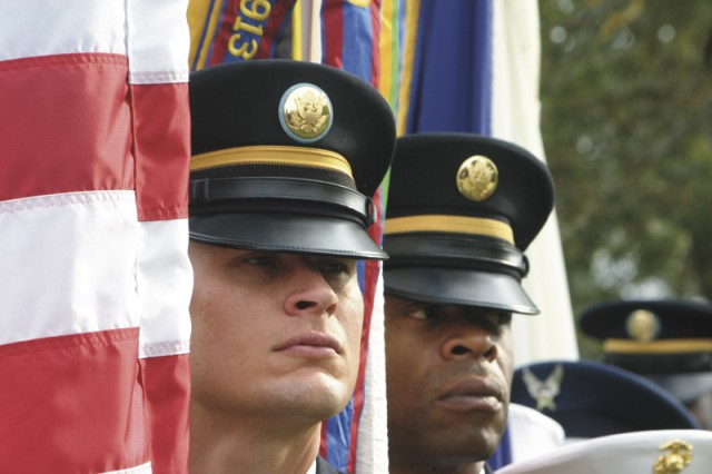Joint color guard members Staff Sgt. Jerry Holcomb and Staff Sgt. Christopher Bell, of the Fort Sam Houston Army Garrison, wait for ceremonies to begin on Veterans Day, Nov. 11, at the Fort Sam Houston National Cemetery.