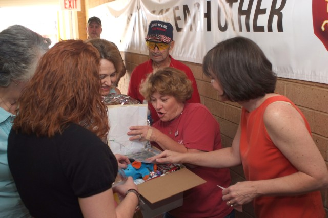 Christmas for Our Troops volunteers fill gift boxes for deployed Soldiers.