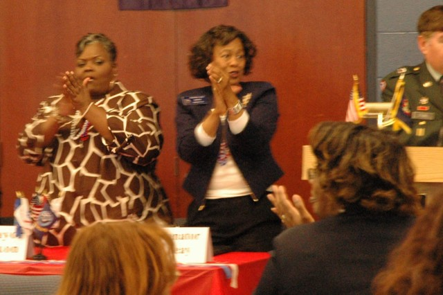 Head table guest, Linda Armstrong, president of the Women's Auxiliary for VFW Post 3650; Mayor Evelyn-Wynn Dixon, mayor of the City of Riverdale; Sen. Valencia Seay, state senator; and Sgt. 1st Class Ron Stubbs, commander, VFW Post 3650, give a standing ovation to veterans from various eras during the luncheon held after  the Veteran's Day parade on Nov. 8, 2008 in Riverdale, Ga.