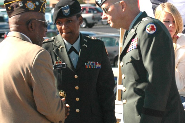 Eugene Burroughs (left), service officer with the Veterans of Foreign War Post 3650 in Riverdale, Ga., briefs Col. Deborah B. Grays (center), commander, U.S. Army Garrison, Fort McPherson and Fort Gillem, Ga., and Maj. Gen. Larry H. Ross, assistant adjutant general for the Defense Support of Civil Authorities Office, on the organization's mission and activities during the Veteran's Day parade held on Nov. 8, 2008 in Riverdale, Ga.