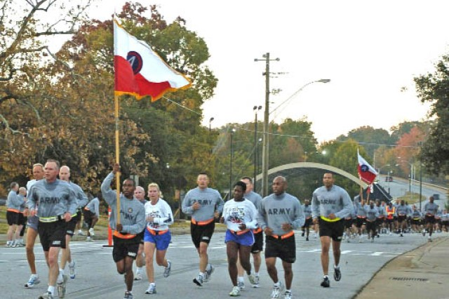 Lovelace leads the formation of officers and NCOs during the run. The USARCENT Army-Ten Miler team also ran at the head of the formation in celebration of their second-place finish in the All Comer's division during the Ten Miler held Oct. 3 in Washington, D.C.  ""