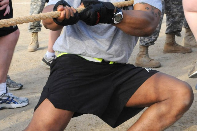 """Staff Sgt. Rowland Iyinbor, personnel sergeant, G-1,  pulls for team USARCENT in the tug-of-war competition, held Nov. 7.  Team USARCENT finished second, losing to 1st Theater Support Command in the finals."""""""