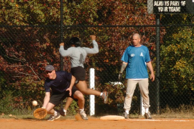 """Lt. Col. Wesley Plybon, deputy plans and operations division, attempts to catch the ball to get Staff Sgt. Michelle Williams, G-1 human resources NCO, out during the softball tournament held Nov. 4 at Fort McPherson. """""""