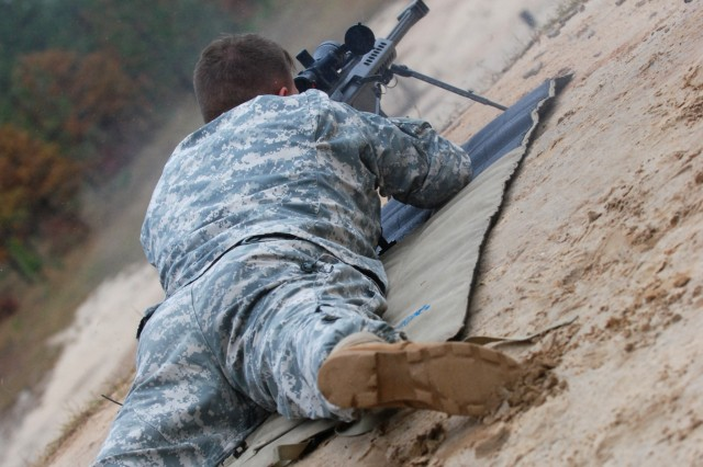 A Paratrooper from the 82nd Airborne Division fires a M107 Caliber .50 Semi-Automatic Long Range Sniper Rifle during a range that Program Executive Office Soldier had several new weapons at for the Soldiers to test. Also visiting the range was Command Sgt. Maj. Dennis Carey, the command sergeant major of U.S. Forces Command, who came out to observe the Paratroopers during his visit to Fort Bragg. (U.S. Army photo by Sgt. Susan Wilt, 2nd BCT, 82nd Abn. Div. PAO)