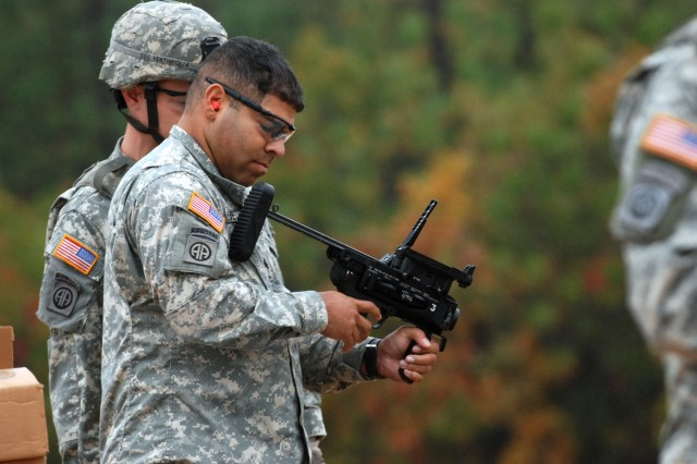 Sgt. Luis Viera, a Paratrooper from Headquarters, 2nd Battalion, 504th Parachute Infantry Regiment, 1st Brigade Combat Team, 82nd Airborne Division, checks out the XM320 Grenade Launcher Stand-Alone with Ladder and Day/Night Sight weapon that he just test fired during a range on Nov 5.  The grenade launcher was one of the several new weapons that Program Executive Office Soldier had out at the range. Command Sgt. Maj. Dennis Carey, the command sergeant major of U.S. Forces Command, also stopped by the range to observe the Paratroopers testing the new weapons during his visit to Fort Bragg. (U.S. Army photo by Sgt. Susan Wilt, 2nd BCT, 82nd Abn. Div. PAO)