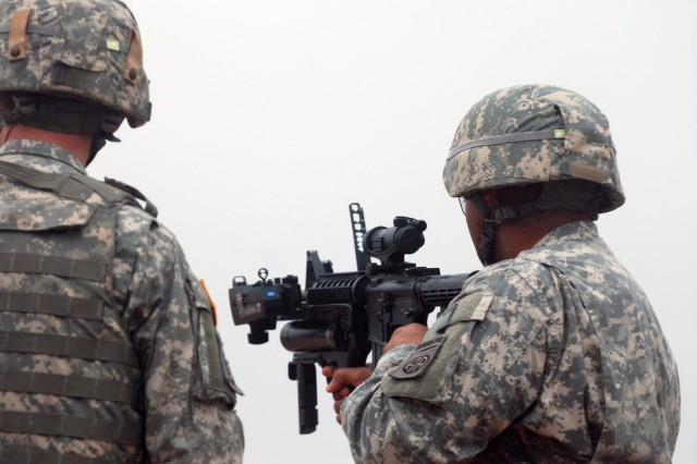 Command Sgt. Maj. Thomas Cappel, the 82nd Airborne Division command sergeant major, test fires a XM320 grenade launcher during a range that Program Executive Office Soldier had new weapons for the Paratroopers of the 82nd Abn. Div. to test on Nov. 5. Cappel came out to the range to observe the Paratroopers, while out there he decided to take advantage of the rare opportunity to test out the new weapon s that could some day be fielded to the Army. (U.S. Army photo by Sgt. Susan Wilt, 2nd BCT, 82nd Abn. Div. PAO)