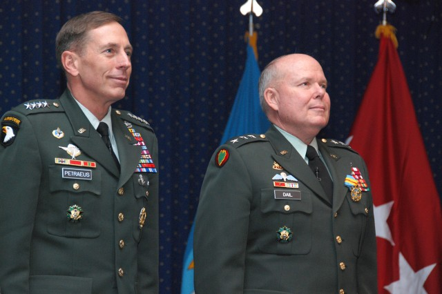 Army Lt. Gen. Robert Dail (right), Defense Logistics Agency director, and Army Gen. David Petraeus, U.S. Central Command commander, stand at attention during the reading of Dail's retirement orders during his Relinquishment of Responsibilities and Retirement Ceremony at the DLA Headquarters' McNamara Auditorium, on Fort Belvoir, Va., Nov. 13.