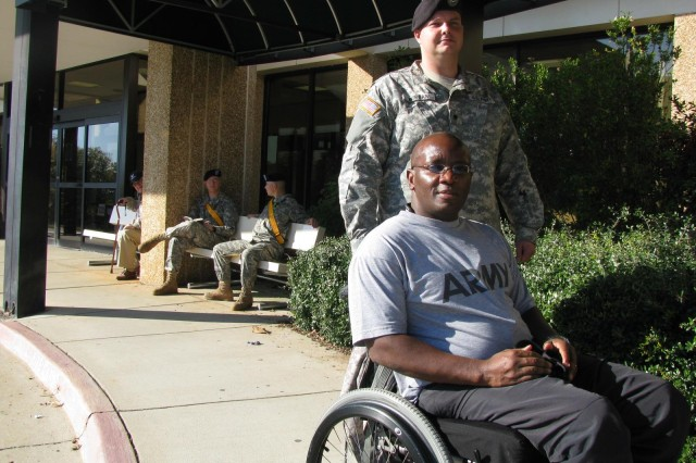 National Guard Maj. W.D. Foster, in a wheelchair, and Spc. Thomas Morgan are both nearing the end of their treatment with the Warrior Transition Unit at Fox Army Health Center. Foster, who suffered a spinal cord stroke while taking a physical training test with his Guard unit, is paralyzed from the waist down. He has received full care at the WTU that has equipped him with the ability to care for himself once he receives a medical discharge. Morgan, who was injured in a vehicle accident while serving in Germany, has nearly completed his medical treatments through the WTU.