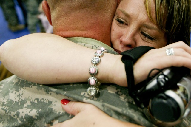 Heather Mathews embraces her husband, Spc. Grady Mathews, Nov. 7, 2008 during a return ceremony for Soldiers of the 514th Medical Company and 547th Medical Company from a 15-month deployment to Iraq.