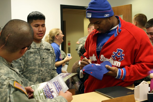 New York Giants defensive end Jerome McDougle signs autographs for Soldiers assigned to West Point's Warrior Transition Unit during a lunchtime visit on Veterans Day. The Soldiers also were visited by Giants offensive guards Kevin Boothe and Grey Ruegamer.