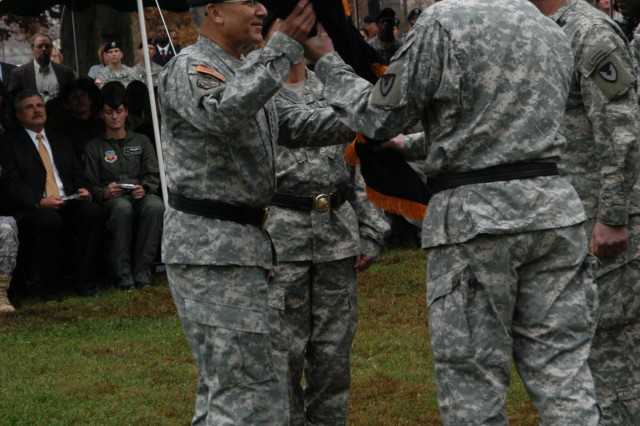 Griffin passes the AMC flag to Casey during Dunwoody and Griffin's change of command ceremony conducted at the AMC parade field, Nov. 14. The passing of the flag symbolizes the transfer of leadership.