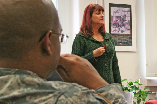 Sgt. Kadhafy Rosario, of the Warrior Transition Unit at U.S. Army Bamberg, Germany, listens intently as a Family Life Consultant addresses WTU Soldiers during a monthly Bamberg Community Library WTU luncheon. The luncheons are aimed at supplying these Soldiers with various tools to aid their recovery.