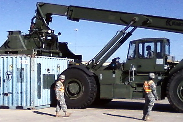 "15th Sustainment Brigade Soldiers move cargo containers using a Rough Terrain Container Handler RT 240 ""Kalmar"" in the first push to deployment of a brigade directly from their motor pools to the port."