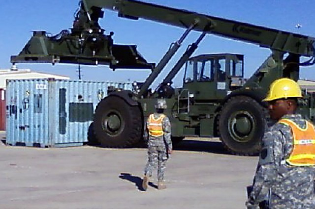"""15th Sustainment Brigade Soldiers move cargo containers using a Rough Terrain Container Handler RT 240 """"Kalmar"""" in the first push to deployment of a brigade directly from their motor pools to the port."""