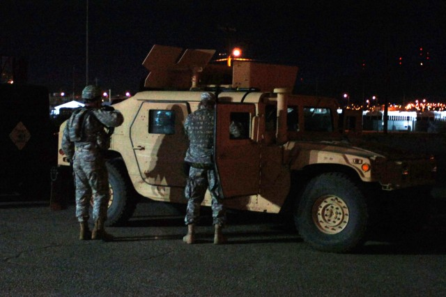Soldiers from the 47th Transportation Company, 180th Transportation Battalion, 15th Sustainment Brigade, make their final preparations and put on their body armor before departing on a training convoy at Fort Bliss, Texas, the night of Nov. 12. The training is meant to prepare the unit for the upcoming deployments to the National Training Center at Fort Irwin, Calif., and later to Iraq.