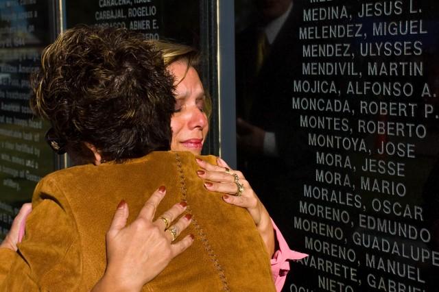 "Norma De La Rosa (facing), granddaughter Company E veteran Lorenzo Luna, hugs District 3 City Rep. Emma Acosta during the unveiling of the ""Men of Company E"" memorial wall Friday at the Chalio Acosta Recreation Center near downtown El Paso."