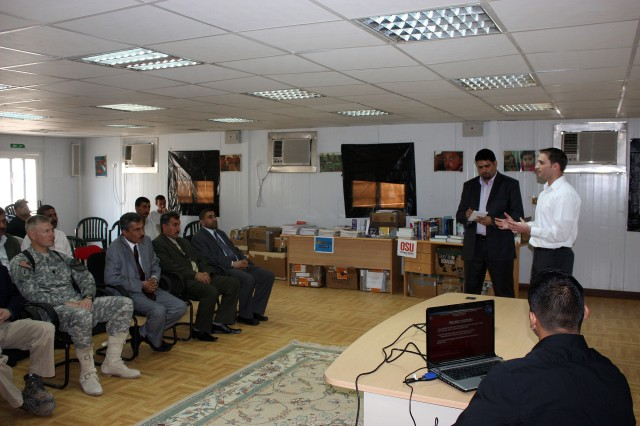 Josh Mater provides a briefing to the Dhi Qar University Chancellor Dr. Ali Ismael al Snafi and university officials Nov. 11 near Nasiriyah.  Mater worked through the Michael Scott Mater Foundation to establish a partnership between Oregon State University and Dhi Qar University