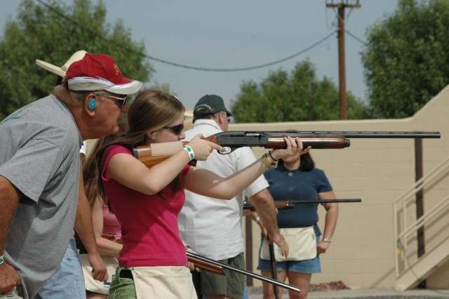 Harry Zuege, an instructor, teaches Katelyn Ivey, a Women in the Outdoors participant, techniques to skeet and trap shoot at the Rod and Gun Club.