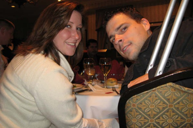 """Army Staff Sgt. Anthony Maschek, right, and his wife, Angela, enjoy a wounded warrior dinner held at the Capitol Hill Club Nov. 14, 2008. Maschek, a 10th Mountain Division infantryman from Twin Falls , Idaho, was shot 11 times causing two broken legs during a February 2008 firefight near Kirkuk in northern Iraq . """"It's really nice,"""" Maschek said of the dinners and other events conducted for wounded troops. """"So many people come in and talk to us and do things for us."""""""