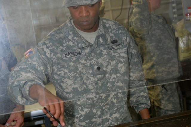 """Spc. Tyrone Barrow, a member of the 2nd Brigade Combat Team, 82nd Airborne Division, Field Kitchen Team, flips steaks before the breakfast portion of the Department of the Army level Phillip A. Connelly Competition starts. The 2 BCT """"Falcon"""" Field Kitchen Team is competing against four other Army units for the title of Best Field Kitchen in the Army. (U.S. Army photo by Sgt. Susan Wilt, 2nd BCT, 82nd Abn. Div. PAO"""