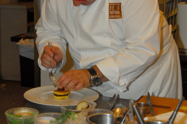 Chef Roberto Donna adds fig preserves to an MRE poppy-seed cake.