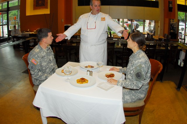 Bon Appetito! Chef Roberto Donna encourages Sgt. 1st Class Randy Randolph and Sgt. Ashleigh Torres to enjoy his Mission: MRE creations.