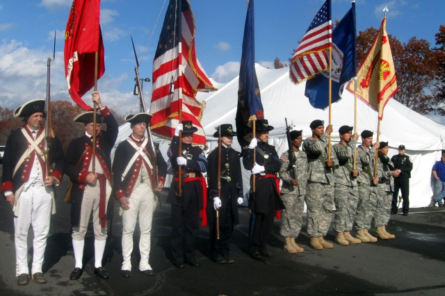 Members of the 1st Virginia Regiment, Sykes' Regulars, and Fort Belvoir, Va., Headquarters Battalion post the colors during the Army Community Covenant Signing Ceremony Nov. 15 at the Woodbridge Campus of Northern Virginia Community College. Hundreds braved sometimes inclement weather to show their appreciation for the nation's servicemembers and their Families and to pay special tribute to Fort Belvoir during an Army Community Covenant Signing Ceremony.