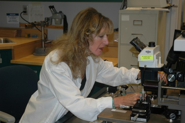 Dr. Melanie Cole, an Army Research Lab scientist, examines material in a lab at the Rodman Building at Aberdeen Proving Ground; Md. Cole was honored with the 2008 Lifetime Achievement Award by the Society of Women Engineers.