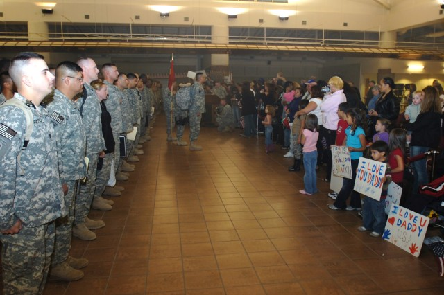 Members of the 377th Transportation Company, a part of the Fort Hood-based 180th Transportation Battalion, 15th Sustainment Brigade, and their families wait to be dismissed during a welcome home ceremony for the Soldiers Nov. 14 at Fort Bliss' Biggs Army Airfield.