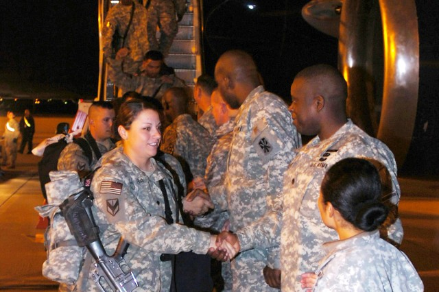 Members of the 377th Transportation Company, a part of the Fort Hood-based 180th Transportation Battalion, 15th Sustainment Brigade, are greeted by members of their leadership as they deplane at Fort Bliss' Biggs Army Airfield Nov. 14. The Soldiers have just completed a 15-month tour in Iraq.