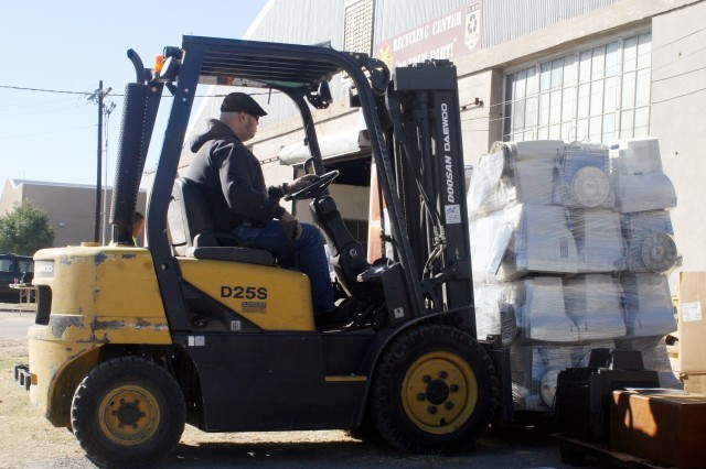 Gilbert Garcia, operations manager for the Fort Bliss, Texas, Recycling Center, uses a forklift to move a pallet of computer monitors area residents turned in during Fort Bliss' E-Day, or Electronics Waste Recycling Day, Nov. 15 at the Fort Bliss Recycling Center.