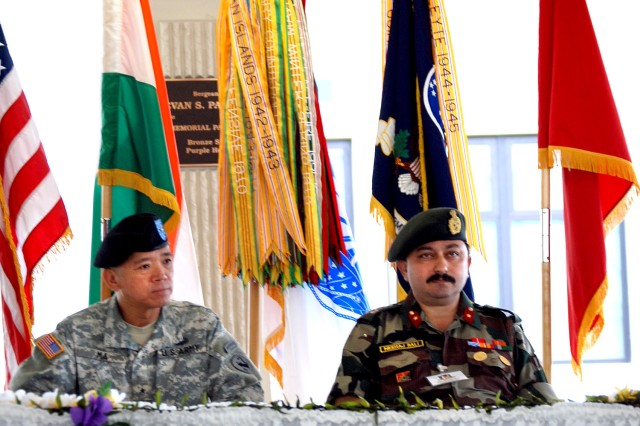 Deputy Commander U.S. Army Reserves' U.S. Command Pacific Brig. Gen. John Y. H. Ma, and Brigadier Nareej Bali of the 49th Brigade Indian Army assume their seats during the opening ceremony of exercise Yuhd Abhyas.