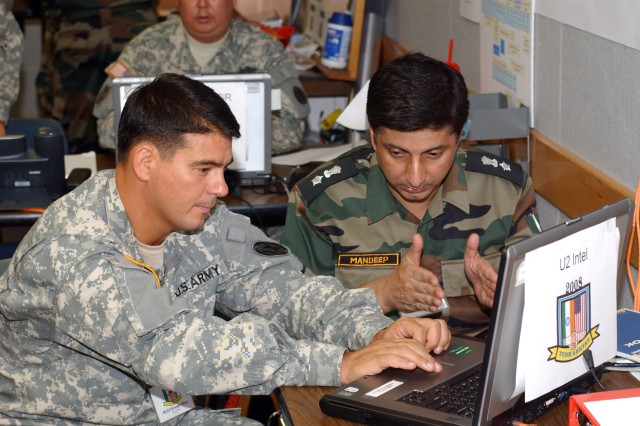 Maj. George Chew, 9th Mission  Support Command G-2 and LTC Mandeep Singh, Intelligence Officer with the 49th Infantry Brigade (Indian Army) confer during the CPX portion of the Exercise Yudh Abhyas 2008 on Ft. Shafter Flats November 1, 2008.